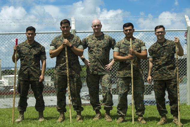 U.S. Marine Cpls. Otto Thiele (center left), Eric Goodman (center), and Christopher Ehms (far right) and Lance Cpls. Antonio Martinez (far left) and Avelardo Guevera Osuna (center right) came together to assist a local Japanese woman during their hike on Mount Fuji, Japan, July 3, 2017. The woman, Oda Moe, was found lying on the ground, hyperventilating and struggling to breathe when the Marines came to her assistance. Together, they created a makeshift stretcher to carry her down approximately two miles to get to medical assistance. The Marines are with Electronics Maintenance Company, 3d Maintenance Battalion, Combat Logistics Regiment 35, 3d Marine Logistics Group, III Marine Expeditionary Force.