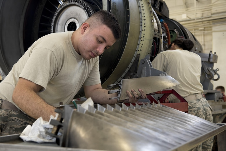 U.S. Air Force Senior Airman Steven Valencia, 18th Component Maintenance Squadron aerospace propulsion journeyman, cleans and inspects fan blades of a TF-34 engine July 6, 2017, at Kadena Air Base, Japan. The fan blades are used to generate approximately 85 percent of the thrust used by A-10 Thunderbolt II aircraft. (U.S. Air Force photo by Senior Airman John Linzmeier)