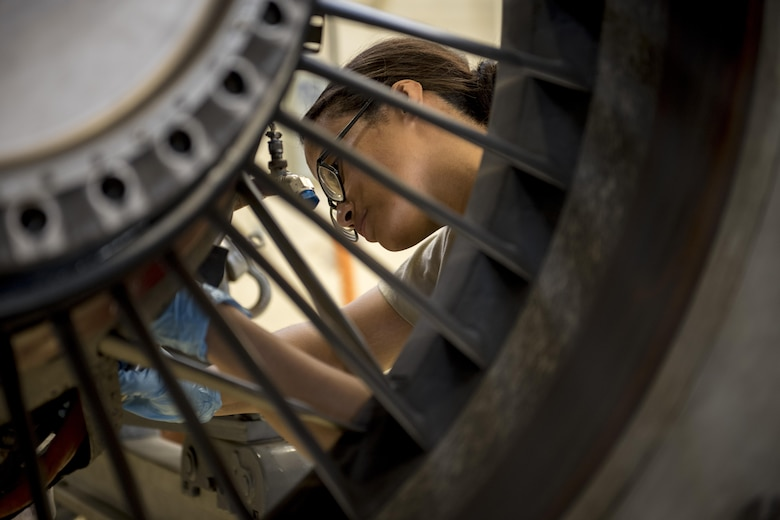U.S. Air Force Airman 1st Class Virgen Hernandez, 18th Component Maintenance Squadron aerospace propulsion apprentice, removes the pressure switch on a TF-34 engine for inspection July 6, 2017, at Kadena Air Base, Japan. The standard process of maintenance is composed of six parts, which are receiving, teardown, inspection, buildup, test cell and the final part, which include inspections of the engine and forms. (U.S. Air Force photo by Senior Airman John Linzmeier)