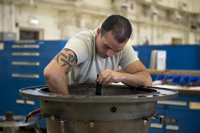 U.S. Air Force Senior Airman Osniel Garcia, 18th Component Maintenance Squadron aerospace propulsion journeyman, inspects the combustion chamber of a TF-34 engine July 6, 2017, at Kadena Air Base, Japan. Jet fuel is released and ignited in the chamber in order to provide power for A-10 Thunderbolt II aircraft. Maintenance Airmen go through along serious of inspections to ensure aircraft are able to operate properly and accomplish the Air Force mission. (U.S. Air Force photo by Senior Airman John Linzmeier)