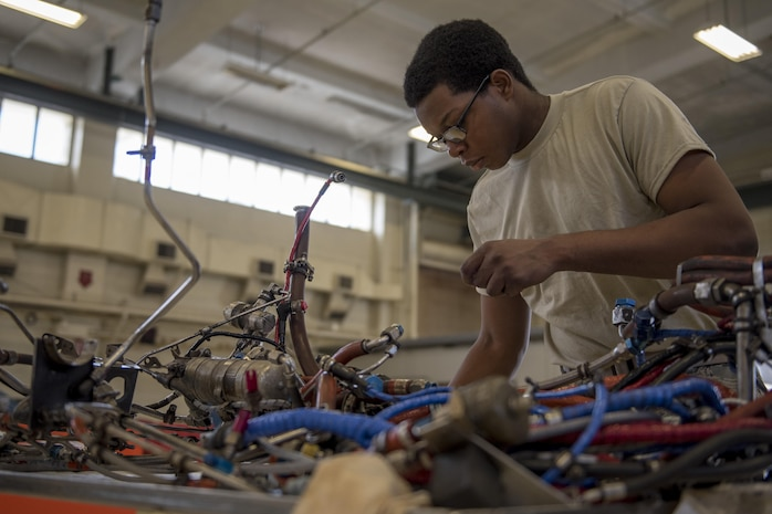 Airman 1st Class Fredrick Merritt, 18th Component Maintenance Squadron aerospace propulsion apprentice, inspects the electric harness of a TF-34 engine July 6, 2017, at Kadena Air Base, Japan. Merritt's shop reconstructs the engines for the 25th Fighter Squadron located in Osan Air Base, Republic of Korea. (U.S. Air Force photo by Senior Airman John Linzmeier)