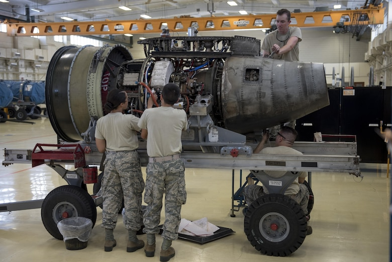 Aerospace propulsion technicians from the 18th Component Maintenance Squadron service an A-10 Thunderbolt II engine July 6, 2017, at Kadena Air Base, Japan. The Airmen performed preventative maintenance, which requires them to completely deconstruct the engine prior to rebuilding it. (U.S. Air Force photo by Senior Airman John Linzmeier)