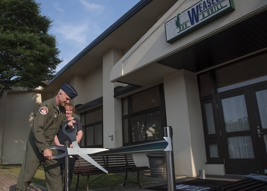 U.S. Air Force Col. R. Scott Jobe, the 35th Fighter Wing commander, cuts a ribbon during the grand opening of the Wild Weasels' Bar & Grill, at Misawa Air Base, Japan, July 7, 2017.  The 35 Force Support Squadron established the eatery to satisfy Misawa AB residents' request for an American style dine-in restaurant. (U.S. Air Force photo by Airman 1st Class Sadie Colbert)