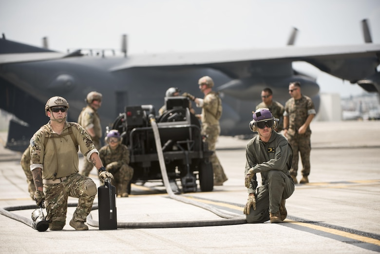 U.S. Airmen from 353rd Special Operations Group and 18th Logistics Readiness Squadron stand by with Marines from Marine Wing Support Squadron 172 to refuel an F-35B Lighting II during a forward area refueling point joint training exercise June 27, 2017, at Kadena Air Base, Japan. The short range take off capability of the 353rd Special Operations Group's MC-130 combined with the vertical takeoff and landing capabilities of the Marine Fighter Attack Squadron 121's F-35B Lightning II enables a fighter presence anywhere in the Pacific.  (U.S. Air Force photo by Senior Airman Omari Bernard)