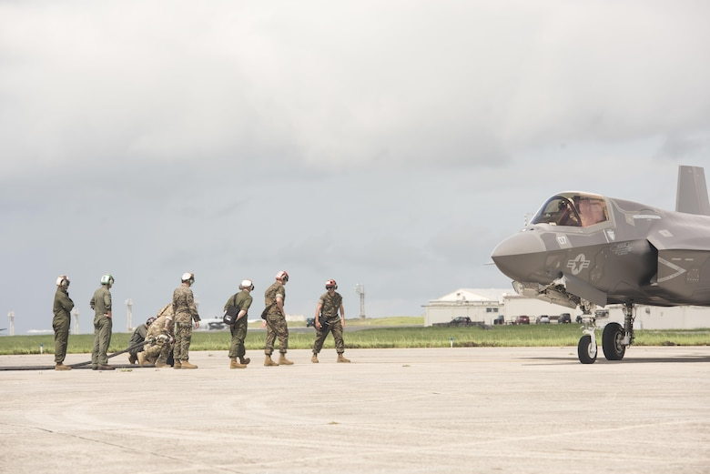 U.S. Airmen from 353rd Special Operations Group and 18th Logistics Readiness Squadron and Marine Wing Support Squadron 172refueling teams ready a fuel hose for a Marine Fighter Attack Squadron 121 F-35B Lightning II during a joint forward area refueling point training exercise June 27, 2017, at Kadena Air Base, Japan. The training between services gave the Marine Corps a unique opportunity to practice joint operations with the 353rd Special Operations Group by utilizing the MC-130J Commando II and MC-130H Talon II's unique ability to air deliver 18th Logistics Squadron ground refueling operations to forward deployed locations. (U.S. Air Force photo by Senior Airman Omari Bernard)