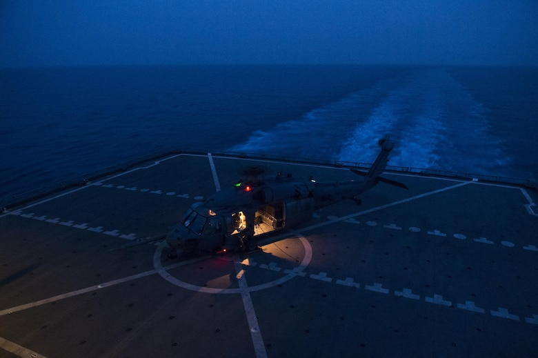 Airmen from the 303rd Expeditionary Rescue Squadron perform deck landing qualification training on the U.S. Naval Ship Washington Chambers, June 27, 2017, near Camp Lemonnier, Djibouti. The 303rd ERQS supports the Combined Joint Task Force-Horn of Africa by providing continuous personnel recovery alert coverage to enable combined forces to counter violent extremist organizations within Eastern Africa and areas of interest. (U.S. Air Force photo/Master Sgt. Russ Scalf)