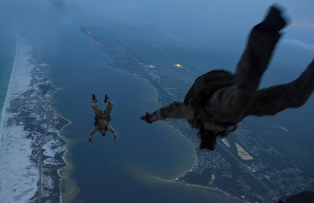 Instructors assigned to the 1st Special Operations Support Squadron, Operational Support Joint Office, jump from a 15th Special Operations Squadron MC-130H Combat Talon II above Northwest Florida, June 28, 2017. The 1st SOSS/OSJ facilitates special operations forces training to ensure global readiness. (U.S. Air Force photo/Airman 1st Class Joseph Pick)