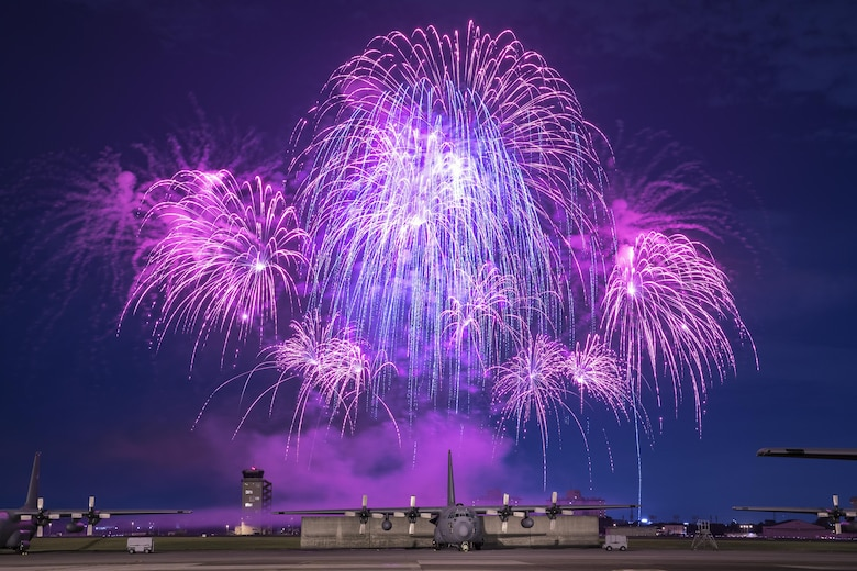 Fireworks explode behind C-130 Hercules during Celebrate America, June 30, 2017, at Yokota Air Base, Japan. Celebrate America is an annual event that provides military members and their families the opportunity to enjoy games, food and bands before culminating in a fireworks display over the Yokota AB airfield to celebrate Independence Day. (U.S. Air Force photo/Yasuo Osakabe)