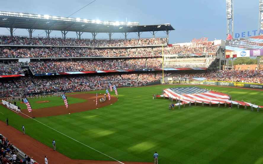 During the opening ceremony everyone in SunTrust Park was encouraged to recite the Pledge of Allegiance to the United States of America. A group of about 80 men and women from the Army, Georgia National Guard, Air National Guard and Air Force Reserve volunteered to help unfurl the flag during the opening ceremony events at the Atlanta Braves game July 4, Atlanta, Georgia.(U.S. Air Force photo by Staff Sgt. Jaimi L. Upthegrove)
