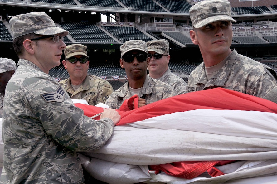 A group of about 80 men and women from the Army, Georgia National Guard, Air National Guard and Air Force Reserve practice unfurled the American Flag and carried it across the field to their specified location. After a few practices the team was released to take a tour and enjoy a buffet while the teams warmed up. At eight p.m. the team participated in the opening ceremony at SunTrust Park at the Atlanta Braves game on July 4, 2017. (U.S. Air Force photo by Staff Sgt. Jaimi L. Upthegrove)