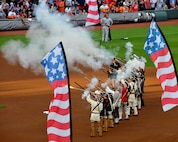 Members of the Georgia Society Sons of the American Revolution Elijah Clark Militia line up to perform a 13 gun salute during the opening ceremony of the Atlanta Braves game at SunTrust Park in Atlanta, Georgia on July 4, 2017. In addition to the salute, a group of about 80 men and women from the Army, Georgia National Guard, Air National Guard and Air Force Reserve unfurled an American Flag in the shape of the United Stated and carried it across the field during the ceremony. (U.S. Air Force photo by Staff Sgt. Jaimi L. Upthegrove)
