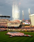 A fireworks display goes off at SunTrust Park during the opening ceremony of the Atlanta Braves game on July 4, 2017. A group of about 80 men and women from the Army, Georgia National Guard, Air National Guard and Air Force Reserve volunteered to help unfurl the flag. (U.S. Air Force photo by Staff Sgt. Jaimi L. Upthegrove)