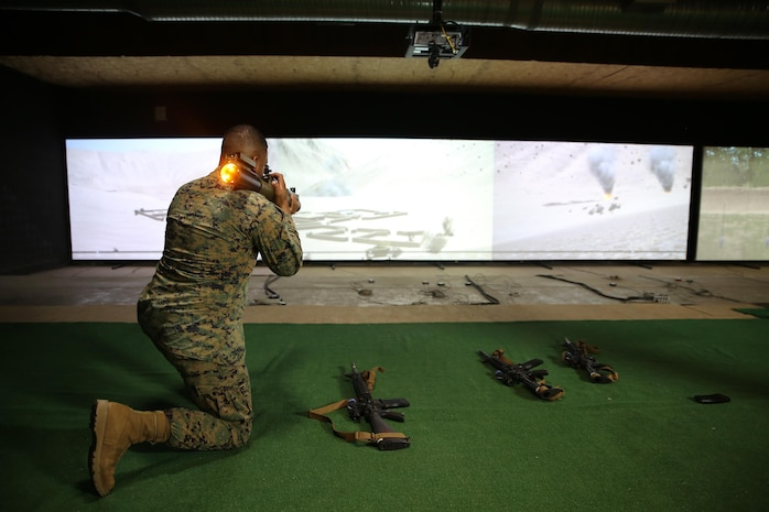 Master Sgt. Jorge Carrillo, staff non-commissioned officer-in-charge at Marksmanship Training Battalion aboard Marine Corps Base Quantico, Virginia, fires an M72 Light Anti-Tank Weapon, one of the new additions to the Indoor Simulated Marksmanship Trainer III. The ISMT III adds three new weapons, 3-D imagery, and enhanced training modes, giving Marines a better, more realistic training experience as they prepare for the complexities of modern warfare. (U.S. Marine Corps photo by Ashley Calingo) [High-resolution photo]