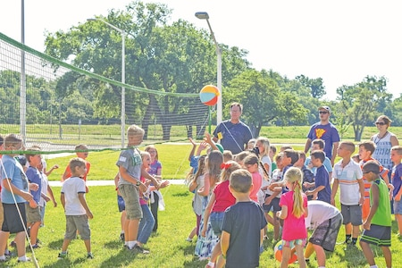 About 60 children from Fort Riley played volleyball while at Victory Chapel as part of Vacation Bible School June 22.