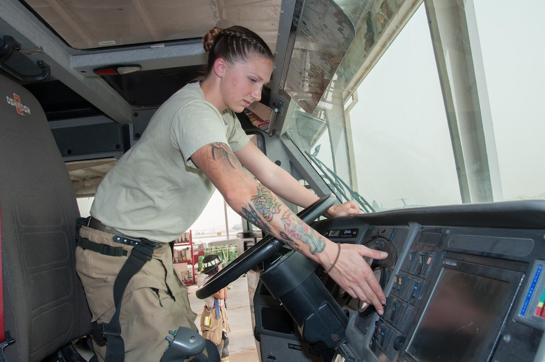 Senior Airman Ashley Eisenbarth, a firefighter assigned to the 386th Civil Engineer Squadron, increases the pump throttle on a fire truck at an undisclosed location in Southwest Asia, June 25, 2017. (U.S. Air Force photo by Master Sgt. Eric M. Sharman)
