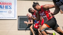 U.S. Marine Corps veteran Leon Pierce, left, races alongside U.S. Marine Corps veteran Guillermo Lopez, right, during the 2017 DoD Warrior Games Track Competition at Lane Technical College Preparatory High School in Chicago July 2, 2017. Pierce, a native of Northridge, Calif., and Guillermo a native of San Antonio, Texas, are a members of Team Marine Corps. The DoD Warrior Games is an adaptive sports competition for wounded, ill and injured service members and veterans.