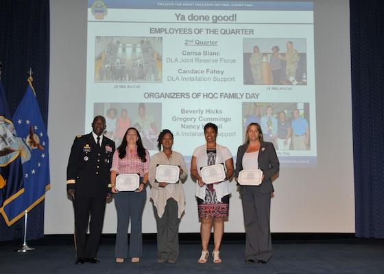 "Army Lt. Gen. Darrell Williams poses with Employees of the Quarter Candace Fahey and Carisa Blanc, as well as their fellow ""DLA Director's 'Ya Done Good' Certificate of Achievement"" winners Beverly Hicks and Nancy Howell (Gregory Cummings not pictured), at the July 6 Director's Town Hall."