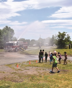 Fire Station 1 stops by the Wet and Wild party at the post library June 23 to cool off the kids. This is the first time Fire Station 1 attended the event.