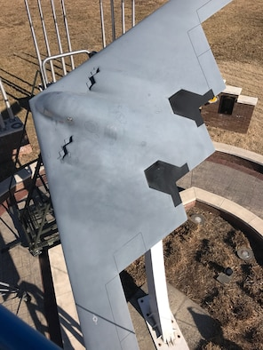 The mini B-2 static display before low observable maintainers from the 509th Maintenance Squadron used the vinyl-wrap technique to restore it at Whiteman Air Force Base, Mo. This technique is an environmentally friendly process that saved the Air Force $18,000. (Courtesy photo)