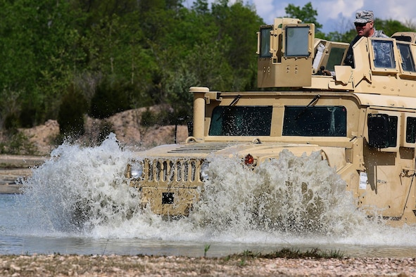 Airmen from the 445th Security Forces Squadron drive a Humvee through rugged terrain for training at the Oakes Quarry Park, Fairborn, Ohio May 6, 2017. The three-day expeditionary training consisted of several phases to include: Humvee mount/dismount, SERE, setting up/tear down tents, and night vision goggles. (U.S. Air Force photo /Tech. Sgt. Patrick O'Reilly)