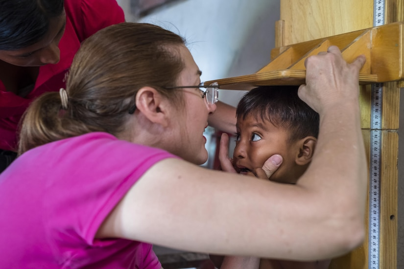 U.S. Army LTC Rhonda Dyer performs anthropometric measurements on a child during a pediatric nutritional assessment mission. Joint Task Force – Bravo Medical Element personnel participated in a pediatric nutritional assessment mission as members of a joint team with the Honduran Ministry of Health to assess the nutritional status of children from the ages of 6 months to 60 months in the San Antonio area of La Paz, Honduras, Jun 14 - 15, 2017.