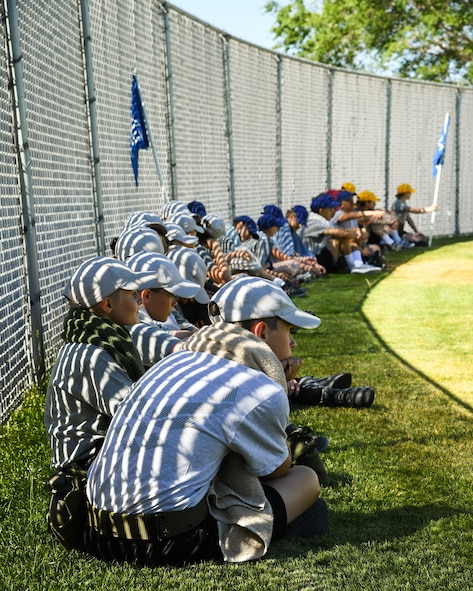 Civil Air Patrol Cadets take a break before a block of instruction and water confidence physical training during the Desert Hawk XV encampment, West Wendover municipal pool, West Wendover, Nevada, June 22, 2017. (U.S. Air Force photo/R. Nial Bradshaw)