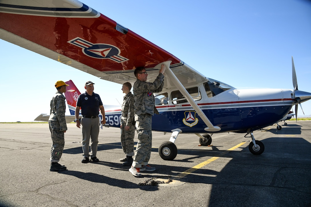 Civil Air Patrol Capt. Paul Jensen performs pre-flight inspections with cadets before an orientation flight, Wendover Historic Airfield, Wendover, Utah, June 22, 2017. (U.S. Air Force photo/R. Nial Bradshaw)
