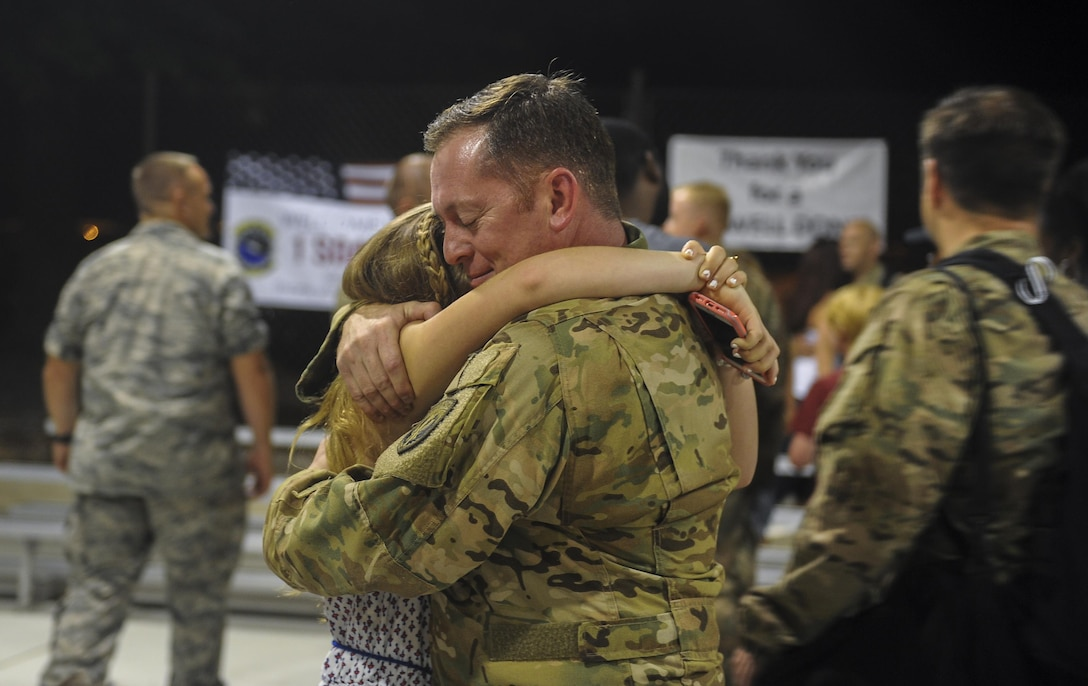 Maj. Scott Reinecke, an AC-130W evaluator pilot with Headquarters Air Force Special Operations Command, hugs his daughter during Operation Homecoming at Hurlburt Field, Fla., July 5, 2017. Operation Homecoming welcomes home Air Commandos from their overseas deployment. (U.S. Air Force photo by Airman 1st Class Isaac O. Guest IV)