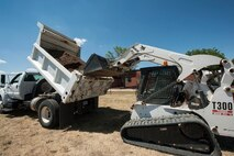 Airman 1st Class Harold McIntyre, 5th Civil Engineer Squadron pavements and equipment technician, uses a Bobcat T300 to remove dirt from a dump truck at Minot Air Force Base, N.D., June 12, 2017. The 5 CES Airmen are trained on a variety of heavy and light-duty equipment. (U.S. Air Force photo by Airman 1st Class Jonathan McElderry)