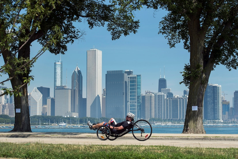 "Master Sgt. Israel ""DT"" Del Toro of Team Special Operations Command races a recumbent cycle during the 2017 Department of Defense Warrior Games in Chicago July 6, 2017. The annual games allow wounded, ill and injured service members and veterans to compete in paralympic-style sports. DoD photo by EJ Hersom"