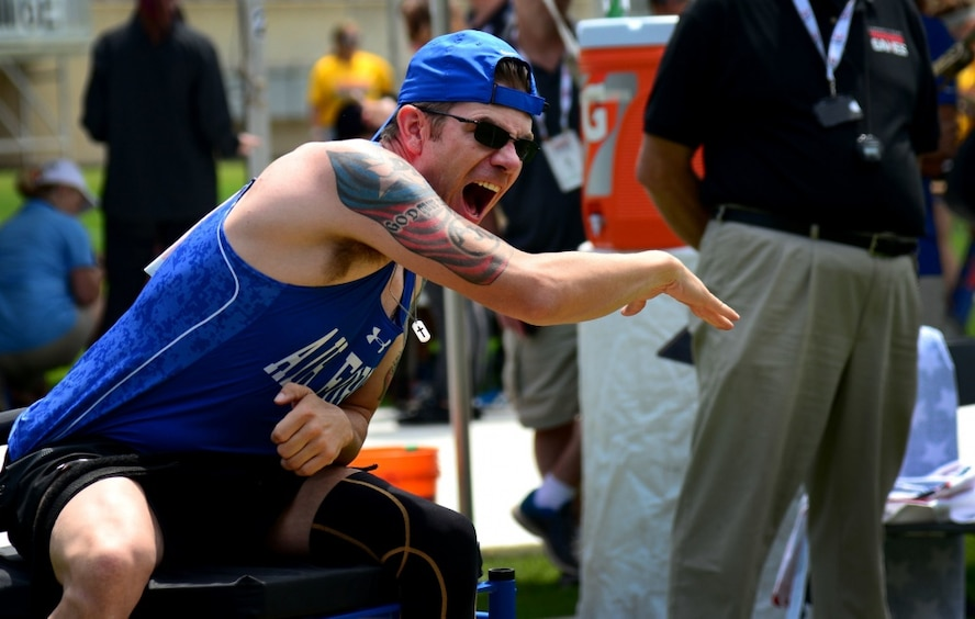 Air Force Staff Sgt. David Olson, an explosive ordnance disposal troop from Abilene, TX, competes in the seated shot put at the 2017 Department of Defense Warrior Games July 5, 2017, at Soldier Field, Chicago, Ill. Olson suffers from post-traumatic stress disorder and a traumatic brain injury, and additionally has had several knee, anterior cruciate ligament and stomach cancer procedures along with needing to wear hearing aids in both ears. (U.S. Air Force photo/Staff Sgt. Alexx Pons)