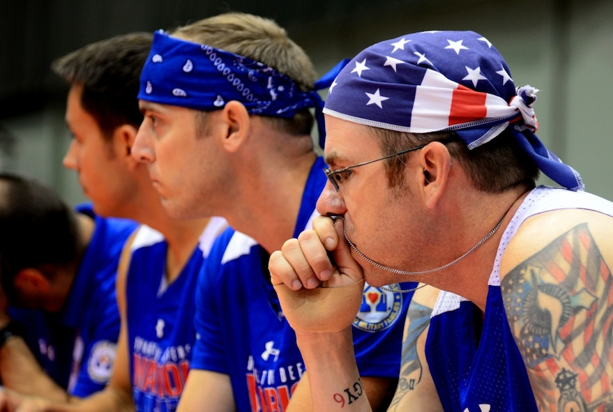 Air Force Staff. Sgt. David Olson, an explosive ordnance disposal troop from Abilene, Texas, says a silent prayer during a sitting volleyball match at the 2017 Warrior Games June 30, 2017, at McCormick Place-Lakeside Center in Chicago. Olson will also compete in field during this year's games. (U.S. Air Force photo/Staff Sgt. Alexx Pons)