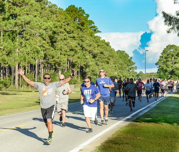 Air Commandos participate in the Command Run at Hurlburt Field, Fla., July 7, 2017. The Air Force Special Operations Command staff meets monthly to run a 5K. (U.S. Air Force photo/Staff Sgt. Melanie Holochwost)