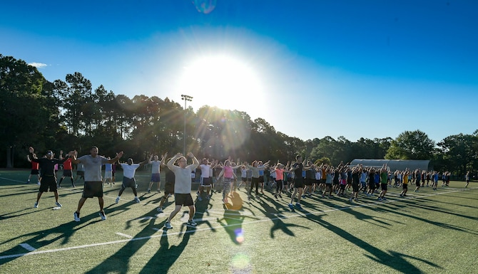 The Headquarters Air Force Special Operations Command staff warms up at Hurlburt Field, Fla., May 5, 2017. These Air Commandos meet the first Friday of every month to run a 5K. (U.S. Air Force photo/Staff Sgt. Melanie Holochwost)