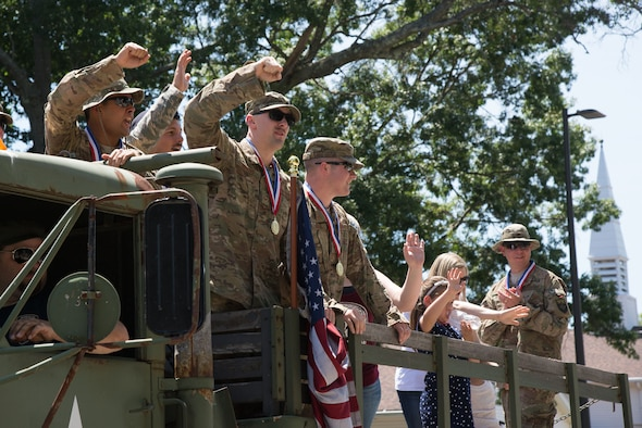 Airmen wave from a vintage military vehicle during the 2016 Heroes Homecoming parade at Hanscom AFB, Mass., July 21. The annual celebration honors military and civilian personnel who have returned from deployment in the past year. (U.S. Air Force Photo by Mark Herlihy)