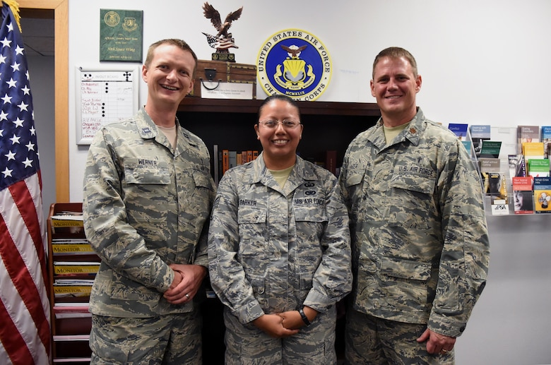 Chaplain (Capt.) Portmann Werner, 50th Space Wing chaplain, Staff Sgt. Marcela Parker, NCO in charge of chapel administration and Chaplain (Maj.) David Hager, Individual Mobilization Augmentee to the Wing Chaplain, gather for a photo at Schriever Air Force Base, Colorado, Wednesday, July 5, 2017. Regardless of one's religious background and beliefs, the Chaplain's Office is here provide a number of services to keep Airmen spiritually resilient and fit to fight. (U.S. Air Force photo/Senior Airman Arielle Vasquez)