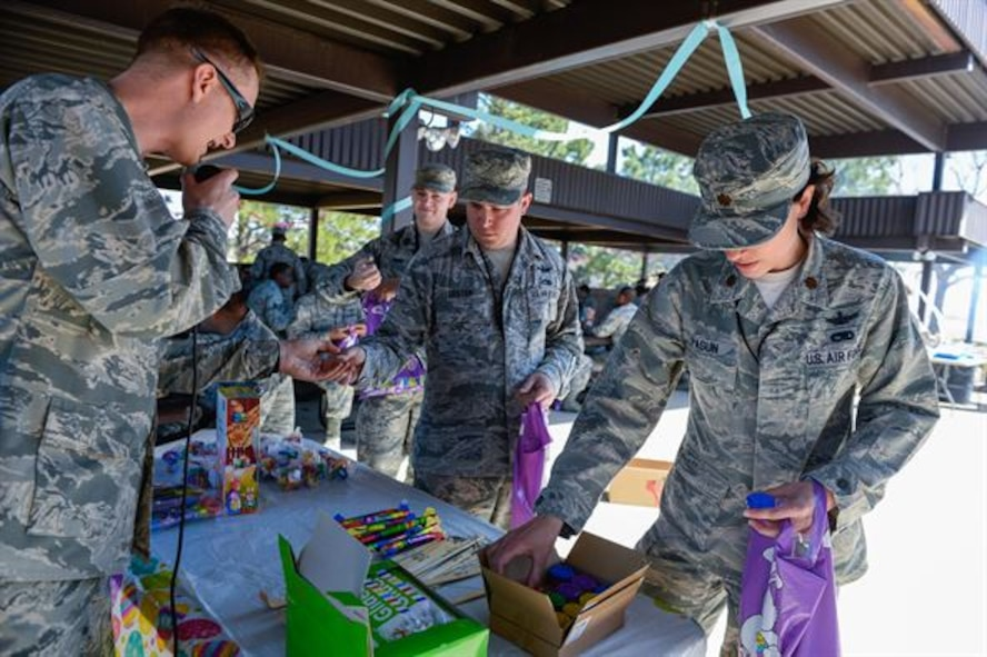 Airmen claim prizes following the 2nd Annual Easter Egg Hunt at Schriever Air Force Base, Colorado, Wednesday, April 12, 2017. The 50th Space Wing Chaplain's Office disseminated more than 1,000 eggs around the Restricted Area in preparation of the many Airmen who came out to participate. (U.S. Air Force photo/Christopher DeWitt)