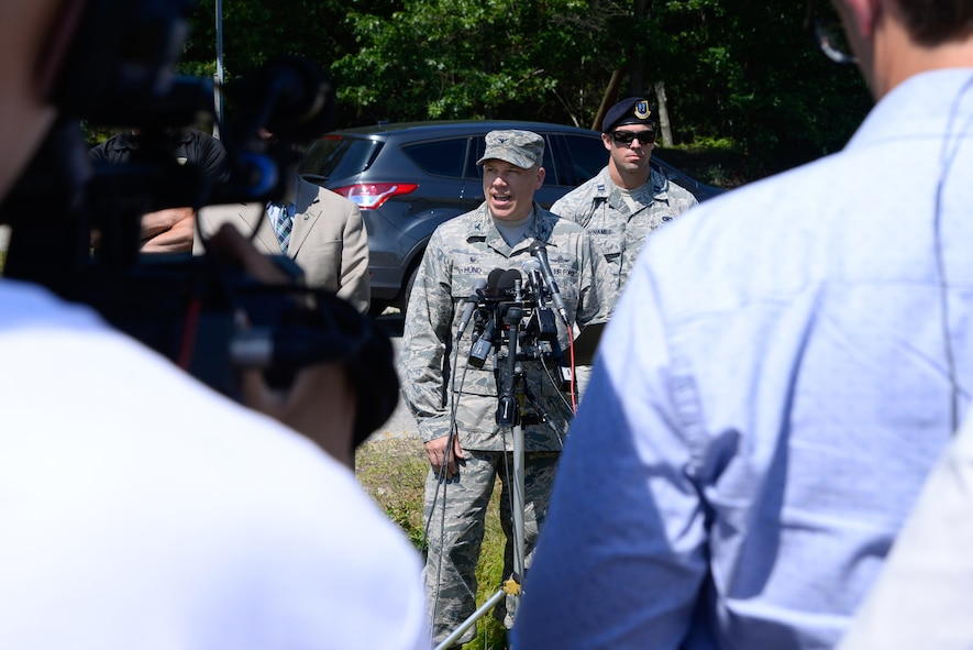 Col. Roman L. Hund, installation commander, speaks to members of the media outside the Vandenberg Gate at Hanscom Air Force Base, Mass., shortly after the base returned to normal operations July 6. Earlier in the day, members of the 66th Security Forces Squadron detected some potentially explosive material during a routine vehicle inspection, which caused officials to close the Vandenberg Gate and evacuate several nearby base facilities. Explosive materials experts from the Mass. State Police eventually cleared the truck and the scene while taking samples from interior containers for additional evaluation. (U.S. Air Force photo by Mark Herlihy)