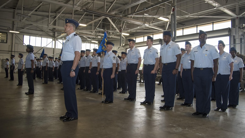 Airmen from the 11th Mission Support Group stand in formation during the 11th MSG change of command ceremony at Joint Base Andrews, Md., July 6, 2017. The 11th MSG is responsible for a $5.4 billion physical plant, 2.5 million-square-yard airfield with two runways, and an $81 million operating budget supporting five alert missions. They are also responsible for the welfare and discipline of more than 60,000 military personnel assigned to the Office of the Secretary of Defense, Headquarters U.S. Air Force and Department of Defense Agencies worldwide. (U.S. Air Force photo by Senior Airman Jordyn Fetter)