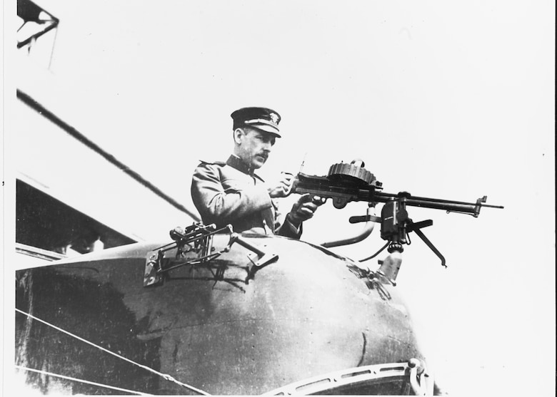 Navy Lt. Arthur E.J. Male, USNRF, in gunner's bow position, with a Lewis aircraft machine gun, at the Naval Aircraft Factory, Philadelphia, Pennsylvania, 25 March 1918. Note bomb sight on the plane's side, beside the gunner. (Photo courtesy Naval History and Heritage Command)