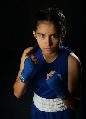 Gracy Kennedy poses for a photo at Minot Air Force Base, N.D., July 5, 2017. Kennedy recently won a national boxing championship for her age and weight bracket. (U.S. Air Force photo/Senior Airman Apryl Hall)