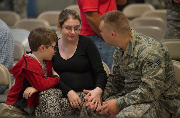 Senior Airman Gary Norman, consoles his wife, Emily, and son Shay prior to deploying in support of Operation Freedom's Sentinel on June 25, 2017, at McLaughlin Air National Guard Base, Charleston, W.Va. Norman is an electrical environmental maintainer with the 130th Airlift Wing. (U.S. Air National Guard photo by Tech. Sgt. De-Juan Haley)