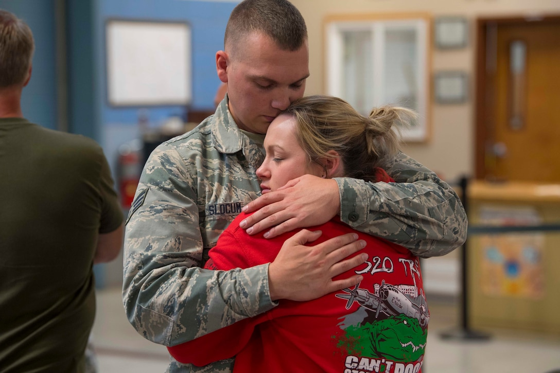 Senior Airman Nathan Slocum says his final goodbyes to a family member before deploying in support of Operation Freedom's Sentinel June 27, 2017. Slocum is a crew chief with the 130th Aircraft Maintenance Squadron, McLaughlin Air National Guard Base, Charleston, W.Va. (U.S. Air National Guard photo by Staff Sgt. Adam Juchniewicz)