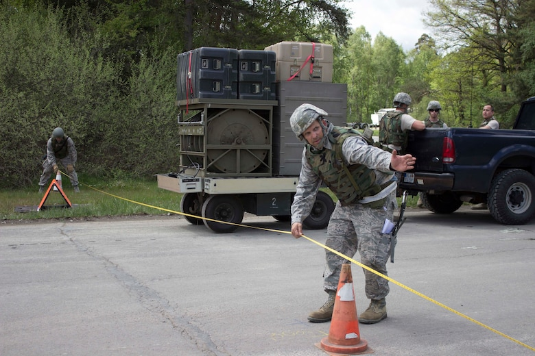 A Silver Flag instructor trains Airmen on the proper measurements during airfield damage repair at Ramstein Air Base, Germany, recently. The training was validated by the force development division of the Air Force Civil Engineer Center. (U.S. Air Force Photo/Susan H. Lawson)