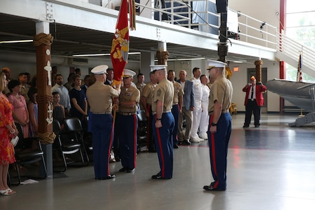 The outgoing commanding officer, Col. Jason Morris, and the incoming commanding officer, Col. David Fallon, exchange the passing of the colors during the 9MCD Change of Command ceremony aboard Naval Station Great Lakes, Ill., on July 7, 2017. (U.S. Marine Corps photo by Sgt. Jennifer Webster/Released)