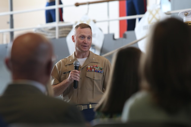 The outgoing commanding officer addresses service member, families and friends during the 9MCD Change of Command ceremony aboard Naval Station Great Lakes, Ill., on July 7, 2017. (U.S. Marine Corps photo by Sgt. Jennifer Webster/Released)