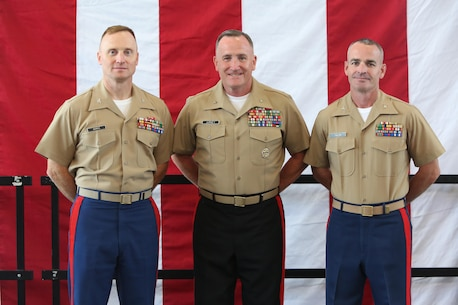The outgoing commanding officer, Col. Jason L. Morris, and incoming commanding officer, Col. David M. Fallon, pose for a photo with the Western Recruiting Region commanding general, Brig. Gen. William Jurney, during the 9MCD Change of Command ceremony aboard Naval Station Great Lakes, Ill., on July 7, 2017. (U.S. Marine Corps photo by Sgt. Jennifer Webster/Released)