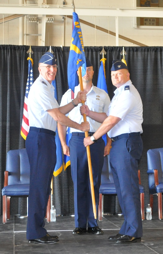 Major Gen. Scott Vander Hamm, assistant deputy chief of staff, operations, Air Force Headquarters, left, hands the guidon to Col. Michael J. Price during a change of command ceremony June 22 at the Will Rogers Air National Guard Base. The colonel took the reins of the approximately 200-member Air Force Flight Standards Agency. Master Sgt. Jeremy Sykora was the guidon bearer. (Air Force photo by John Parker)