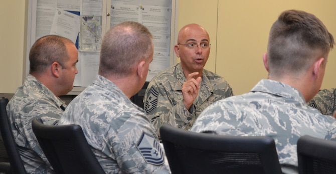 Twelfth Air Force (Air Forces Southern) Command Chief Master Sgt. Alex del Valle, answers a question during a luncheon with Noncommissioned Officers from the 552nd Air Control Wing, June 29. Chief del Valle toured the Wing and attended the Wing change of command ceremony. (Air Force photo by Ron Mullan)