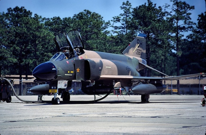 An F-4D Phantom II assigned to the 507th Tactical Fighter Wing, Air Force Reserves at Tinker, shown on the flight line during a training deployment during the 1980s. This jet wears a Vietnam-era MiG-kill marking in the form of a red and yellow star on the intake splitter-plate. (Courtesy photo by Don Jay)